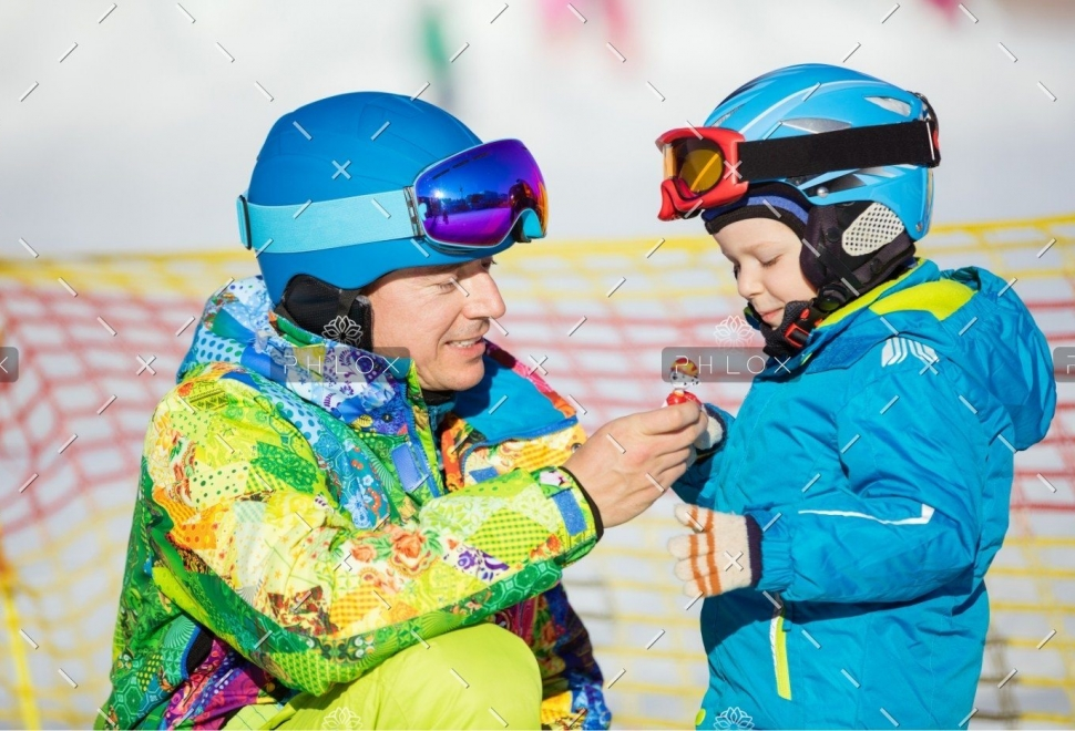demo-attachment-148-father-and-little-son-in-skiing-outfits-playing-PMSY642